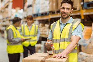 Man in warehouse smiling