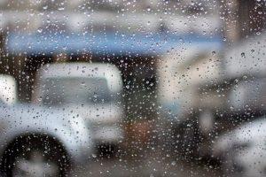 Rain on windshield by garage