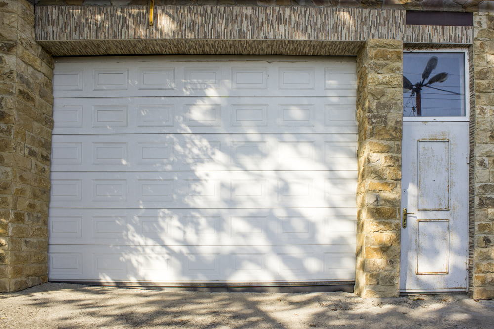 comparing residential commercial garage doors